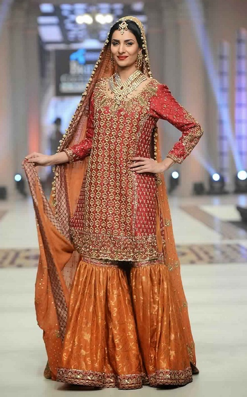 red kurta and orange sharara