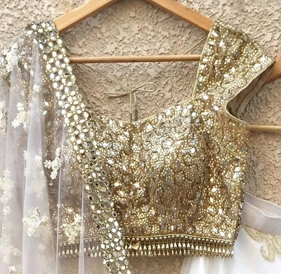 Golden blouse with mirror work
