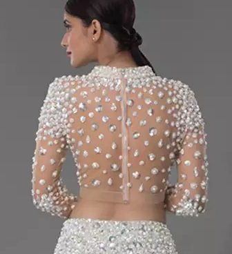 Backless blouse design with pearl and stones