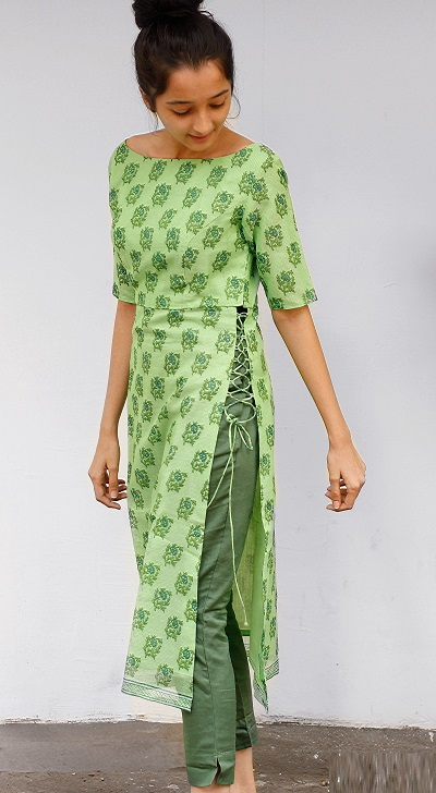 Stylish side string kurti with solid green trousers