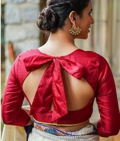 Backless blouse with bow shaped pattern