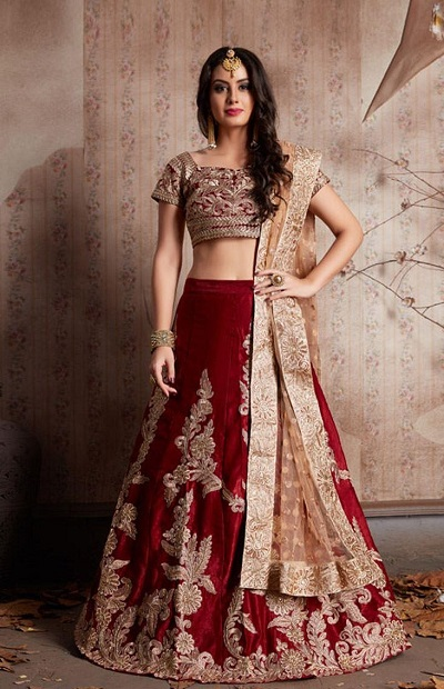Bright red bridal lehenga with golden dupatta