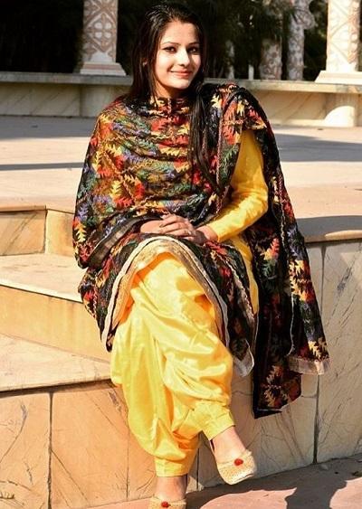 Multi colour black Phulkari Dupatta with Silk full sleeves yellow suit