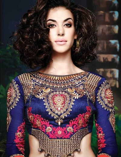 Blouse with heavy embroidery and waist flap