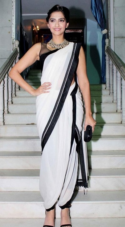 Black and white dhoti saree style for weddings