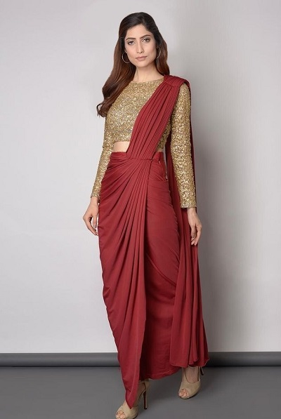 Stylish Golden glitter blouse with red dhoti style saree