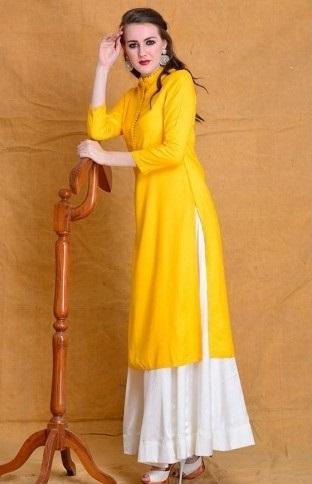 Yellow rayon 3/4 sleeves kurta with white full flared skirt