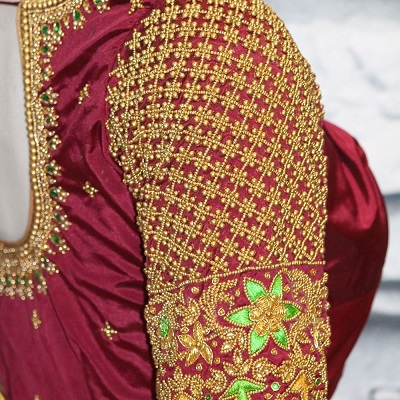 Heavy embroidered maggam work saree blouse design